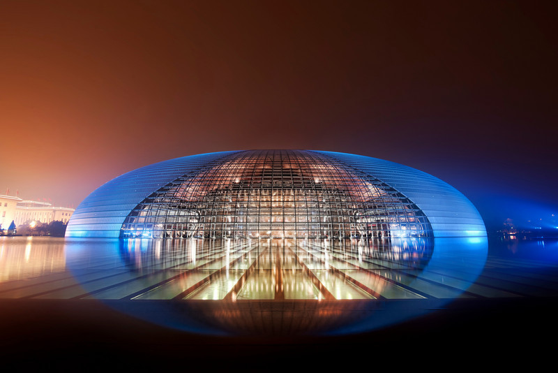 "<h2>The Chinese Mothership</h2> <br/>Look at this magical place in Beijing... it's on the edge of belief.<br/><br/>I could hardly fathom the nature of this place.  I expected the lights to appear on the grid with melodic tones a mystical, alien language, like in Close Encounters.  But none of that happened...  So I just stood there for a long time, thinking about how incredible this place was... and took my time, setting up my system for a fitting photograph.<br/><br/>Remember when we were kids, and we never finished our food, even under the threat of starving children in China?  Now, I say to my kids, you better eat your food, or else Chinese children will grow up and create an economic powerhouse.  Well too late for that!<br/><br/>This is the amazing National Centre for the Performing Arts, or as I like to say, the 国家大剧院 -- I find that rolls of the tongue a bit easier.<br/><br/>- Trey Ratcliff<br/><br/><a href=""http://www.stuckincustoms.com/2011/01/26/national-centre-for-the-performing-arts-the-egg/"" rel=""nofollow"">Click here to read the rest of this post at the Stuck in Customs blog.</a>"