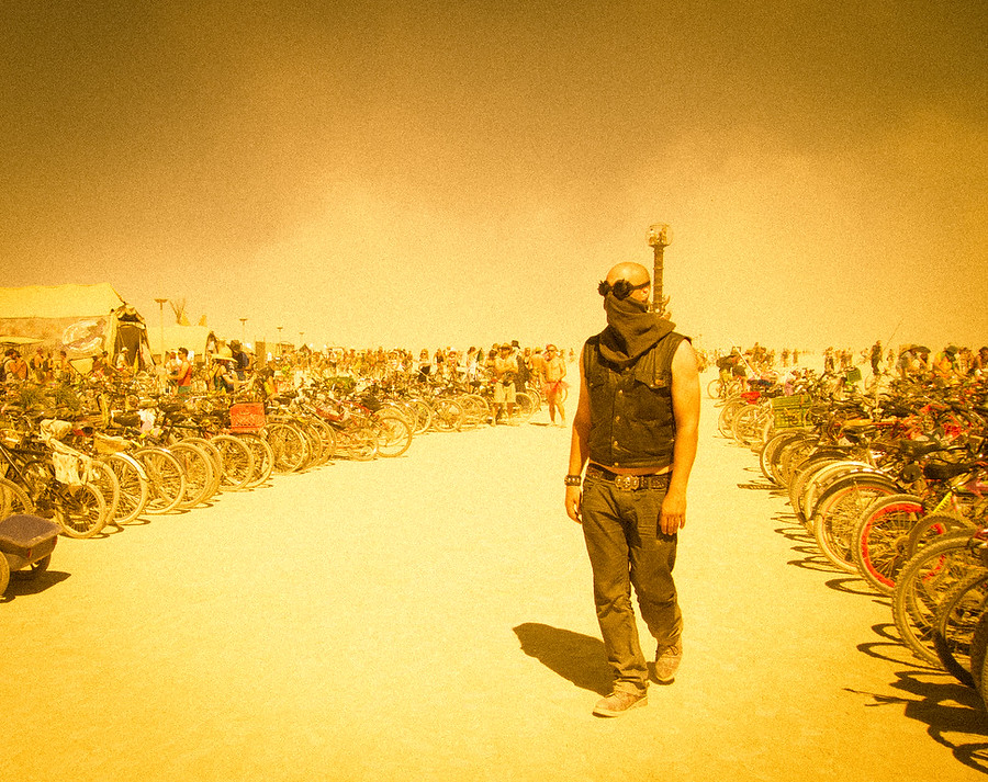 Most people roamed the desert wearing goggles to protect ourselves from the sand and sun.  For me, everything had an orange tint, so I've used the same technique in many of my photos of the event.