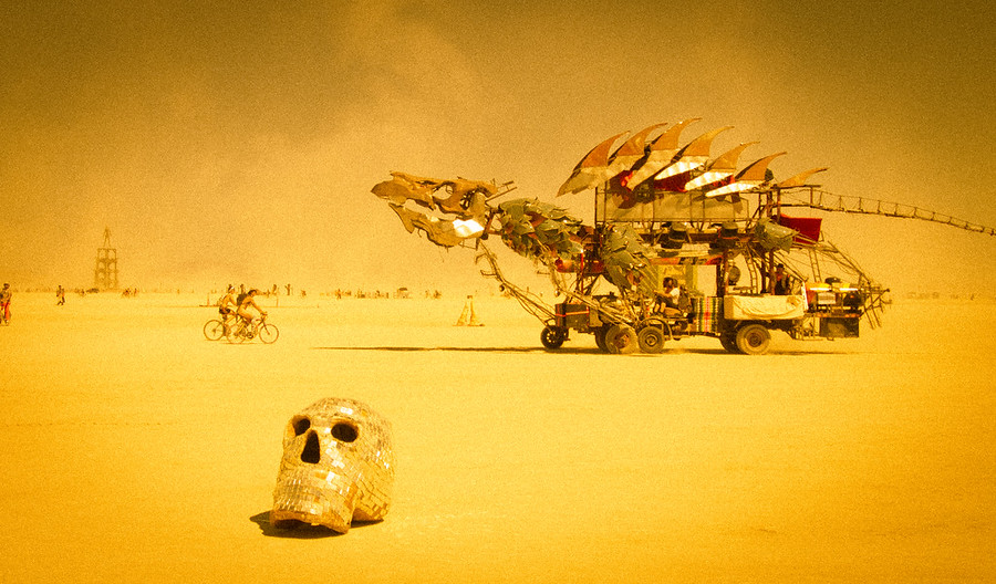 People spend all year building elaborate land-vehicles that cruise around the playa day and night. This one is particularly awesome, with a fully articulated head that can breathe fire at night (pics of that coming soon!).