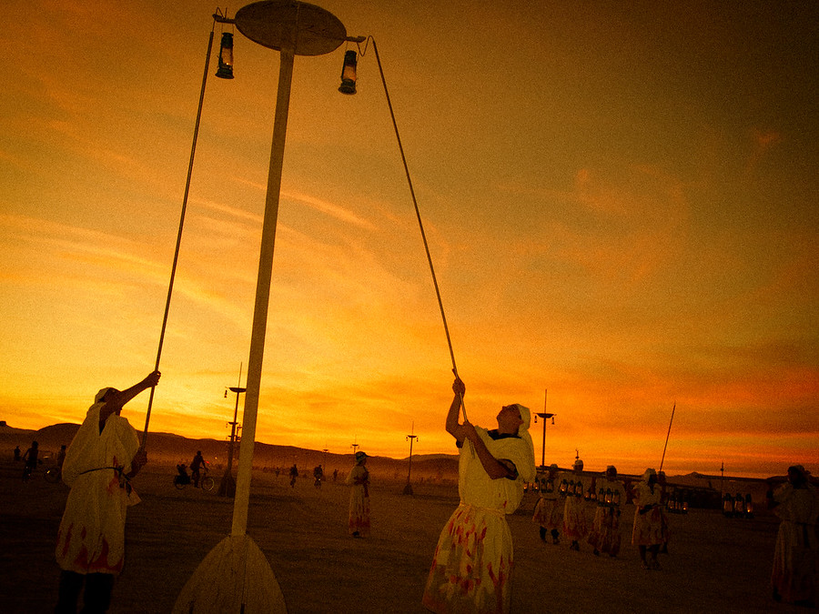 Daily Photo(s): One Week Till Burning Man!Every night as the sun is setting, these lamplighters come out with lanterns and hang them high along the main roads in the make-shift city.- Trey RatcliffSee the rest of this batch (and a link to all Burning Man photos) here at the Stuck in Customs blog.