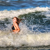 "<h2>Girl in Ocean</h2> I got this 600mm from BorrowLenses.com to take photos of the shuttle on my first trip.  Since the shuttle didn't take off, Scott and I decided to go to the beach and take photos of girls from a distance like real creeps.  I openly admit it... we looked downright creepy up there with two huge lenses, peering in every which direction until we saw something interesting.    Then I saw this gal splashing around in the waves with her friends... seemed like a good subject so I took a few shots.  With the 600mm I was so far away, that she would have had no idea I was taking them.  This made it all feel <em>even more sketchy</em>, but, you know, having said all that, I'm quite happy with the shot.  - Trey Ratcliff  Read the rest <a href=""http://www.stuckincustoms.com/2011/07/02/girl-in-ocean/"">here</a> at the Stuck in Customs blog."