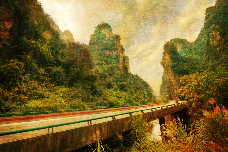 "<h2>Driving through Remote China</h2> <br/>I took a six hour drive through part of the Hangzhou. At some point, it began to get very hilly and moody. The ride was a little rough, so I would pull over from time to time to take breaks.<br/><br/>One time when I popped out, I thought the road and the scene felt fairly cinematic. I went through the old routine of opening up the tripod for a shot… <br/><br/>- Trey Ratcliff<br/><br/><a href=""http://www.stuckincustoms.com/2012/11/12/32507/"" rel=""nofollow"">Click here to read the rest of this post at the Stuck in Customs blog.</a>"