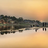 "<h2>The Rest of the India Story</h2> <br/>So, I took this photo from across a slow-moving river. After shooting, I explored a bit more as the sun was setting, then returned to the same spot, rotating the camera about 45 degrees to the right. This is what I saw.<br/><br/>In the distance, you can see how it is a layer of smoke in the air. This is where families come from all over the Agra area to burn the bodies of recently deceased loved ones. They then throw some ashes in the river to begin the cycle again. Indians come from all over the area to visit this river, see the Taj Mahal, and visit other local temples. It's a very peaceful place… I hope this photo helps to describe the general feeling of the place.<br/><br/>- Trey Ratcliff<br/><br/><a href=""http://www.stuckincustoms.com/2010/09/02/the-rest-of-the-india-story/"" rel=""nofollow"">Click here to read the rest of this post at the Stuck in Customs blog.</a>"