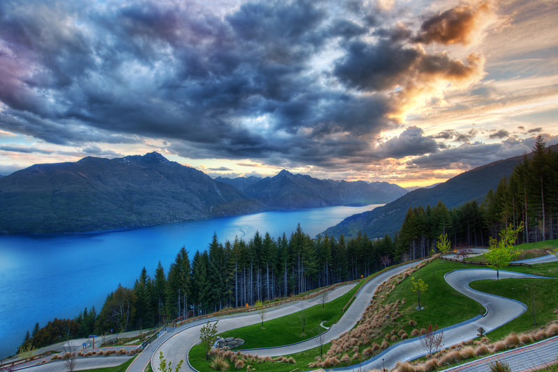"<h2>Cart Racing in Queenstown</h2> <br/>This may be my son's favorite thing about Queenstown!  In the summer, they open up this area at the top of the mountain where you can luge all day long.  He never gets tired of it – and neither do I!  When we go back, we'll have to see if we can get some kind of a season pass or something.<br/><br/>He gets a little rough, and he's a little bit ruthless.  But I have a good 100 pounds on him, which helps everywhere except for the curves.  He spins around the corners like Yoshi, and I'm a little more like Bowser…<br/><br/>- Trey Ratcliff<br/><br/><a href=""http://www.stuckincustoms.com/2012/05/08/cart-racing-in-queenstown/"" rel=""nofollow"">Click here to read the rest of this post at the Stuck in Customs blog.</a>"