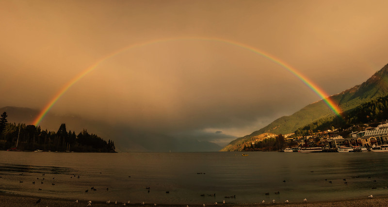 Rainbow over the Lake in Queenstown I had just dropped my kids off for their first day of school. I had my D3S with me because I was taking photos of that momentous event, so it was still with me when I went downtown to sign some papers. When I got downtown, the rain was just starting to slow down, but there was still a thick morning dampness in the air over the lake, and a full rainbow was right in front of me. I didn't have the right equipment with me to get the rainbow all at once, so I went through the steps listed above! :)- Trey RatcliffClick here to read the rest of this post at the Stuck in Customs blog.