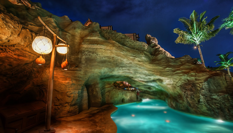"<h2>Swimming Through the Grotto</h2> <br/>The swimming pool at the Aulani (a Disney hotel) on Oahu is pretty incredible. I only saw the place at night, so I'm not sure how it looks during the day. But it looks like it was designed just so that it would look awesome at night!<br/><br/>It's attached to one of those lazy rivers that bends around this way and that. I do like lazy rivers, but I don't like all the Disney lifeguards watching me on every bend. What if I want a little lazy-river privacy? Well, I guess there's no need for that with kids about and such.<br/><br/>- Trey Ratcliff<br/><br/><a href=""http://www.stuckincustoms.com/2012/07/25/swimming-through-the-grotto/"" rel=""nofollow"">Click here to read the rest of this post at the Stuck in Customs blog.</a>"