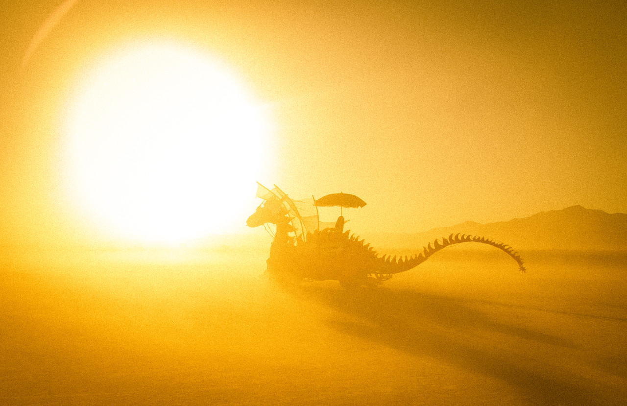The mighty dragon flew strong against the sandstorm. It blew and ripped, and the sand scoured and blasted through the structure with it a long hollow whistle.  There was no sound but that deep sigh of the wind trying to pull apart the mighty beast.  The sound was of a long and empty death.