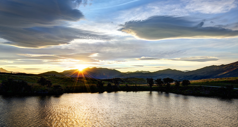 """<h2>Across the Little Lake at Sunset</h2> <br/>Here's a little tip for shooting and getting those sun rays that burst out like that. So, you may have heard that you can set your f-stop as high as it can go… say, f/22 or something. But, you actually don't have to go quite that high. The bad part about maxing it out is that you'll see all the dust on your sensor and all the little bits on your lens. That takes a long time in post to clean up. Instead, try around f/16 or f/14… you can still get that nice effect without all the junk getting in the way! :)<br/><br/>- Trey Ratcliff<br/><br/><a href=""""http://www.stuckincustoms.com/2013/03/15/across-the-little-lake-at-sunset/"""" rel=""""nofollow"""">Click here to read the rest of this post at the Stuck in Customs blog.</a>"""