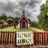 """<h2>The Lonely Church</h2> <br/>There is a beautiful little French seaside town on the east coast of New Zealand called Akaroa.  We spent a few days here to relax and explore.  After taking a drive a bit further from the town up the coast, we found this old church on the side of the road.  Of course.... it's impossible to drive by a place like this without popping out for a photo!<br/><br/>After taking so many shots, I can now say that I like cloudy days more than flat blue sunny days.  In fact, I'll just pass by a lot of scenic places if the sky is a boring blue.  One common problem that many people notice with HDRs is that there is a """"halo"""" effect.  This happens a lot with those blue-sky days...  A great way to get around that problem is simply to wait for sunset, a cloudy day, or something where there is not a vast expanse of flat color.<br/><br/>If you want to find out more about the technique, check out the full <a href=""""http://www.stuckincustoms.com/hdr-tutorial/"""">HDR Tutorial</a>.<br/><br/>- Trey Ratcliff<br/><br/><a href=""""http://www.stuckincustoms.com/2010/05/18/the-lonely-church/"""" rel=""""nofollow"""">Click here to read the rest of this post at the Stuck in Customs blog.</a>"""