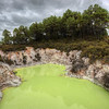 "<h2>The Green Pool</h2> <br/>The northern island of New Zealand has a geothermal area in Rotorua called Wai-o-tapu that is filled with these strange places.  One of the best things about these are the names... Various mysterious pits have names like the Devil's Throat, Hell's Gate, and Devil's Cauldron.  You don't want to drop your cell phone in any of these.<br/><br/> - Trey Ratcliff <br/><br/>Read more and see a behind-the-scenes video <a href=""http://www.stuckincustoms.com/2010/10/27/the-green-pool-of-new-zealand/"">here</a> at stuckincustoms.com."