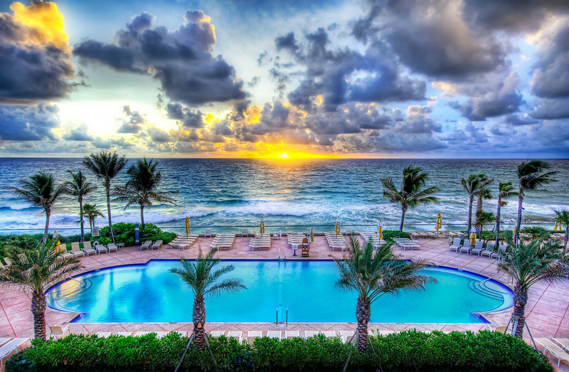 """<h2>There's a pool party at sunset - everyone mark your chair with a towel</h2> <br/>I have the pool reserved for all of us! Be sure to mark down what you'll be bringing along (and if you are on Flickr mark your chair with a note)!<br/><br/>I think pretty much all kinds of food and drink are welcome. I'll bring a BBQ pit and an ambulance in case there are any problems. And I hope someone brings a boom box. Are they still called that? I don't know. Maybe that means it will be a lame party because I don't even know if they are called boom boxes any more, but I'm sure I'm not the only one that will bring a bit of 80's music.<br/><br/>- Trey Ratcliff<br/><br/><a href=""""http://www.stuckincustoms.com/2009/02/06/theres-a-pool-party-at-sunset-everyone-mark-your-chair-with-a-towel/"""" rel=""""nofollow"""">Click here to read the rest of this post at the Stuck in Customs blog.</a>"""