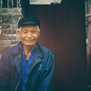 "<h2>Man in Hutong</h2><br/>These are some of the most off-the-map areas in and around the cities of China.  These Houtongs originally meant ""water wells"" and were established during China's dynastic period.  They still exist today as little cultural centers where old families live and work and sit on the steps and watch the world go by…<br/><br/>- Trey Ratcliff<br/><br/><a href=""http://www.stuckincustoms.com/2012/05/23/man-in-houtong/"" rel=""nofollow"">Click here to read the entire post at the Stuck in Customs blog.</a>"