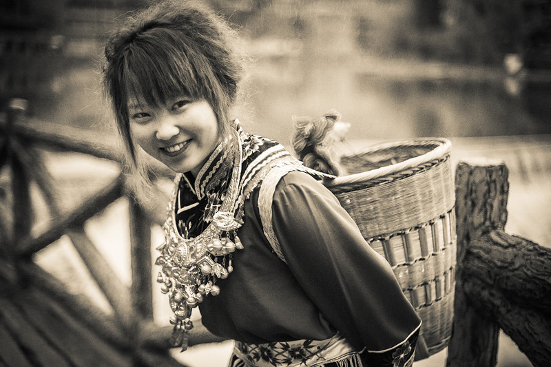 """<h2>Girl Carrying Basket in China</h2> <br/>These out-of-the-way places are some of the best for photography because the locals actually like photographers from the west. About 98% of the time they find us interesting and worthy of a smile. They seem to like the attention we give them with our cameras and there are many smiles to be had.<br/><br/>I don't take a lot of photos of people smiling, because I like to take photos before people notice or right as soon as they notice. Usually though, everyone smiles after I take a few… I do a few facial maneuvers so that they feel more comfy.<br/><br/>- Trey Ratcliff<br/><br/><a href=""""http://www.stuckincustoms.com/2012/09/04/girl-carrying-basket-in-china/"""" rel=""""nofollow"""">Click here to read the rest of this post at the Stuck in Customs blog.</a>"""