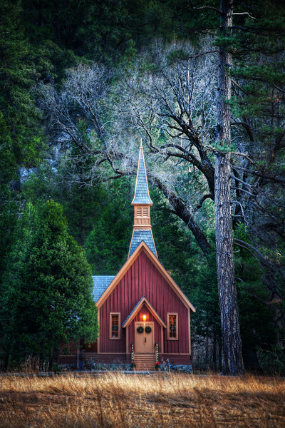 """<h2>Little Church in Yosemite</h2> While in the meadows between the mountains of Yosemite, I did not expect to see this little church.<br/><br/>And waiting for the right kind of light was another challenge.  The light down in the valley is so strange.  The sheer walls of the mountains on both sides are so steep that the sun disappears quite early in the day.  Everything becomes a little-bit-dreamy then, and I felt like that was a good time to take the shot.<br/><br/>- Trey Ratcliff<br/><br/><a href=""""http://www.stuckincustoms.com/2012/03/02/little-church-in-yosemite/"""" rel=""""nofollow"""">Click here to read the rest of this entry at the Stuck in Customs blog.</a>"""