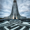 """<h2>The Labyrinth Rocket</h2> <br/>Isn't this a beautiful and unique church?  It's been so long since I've posted a photo of it.  It's called Hallgrimskirkja.  This is much easier to say if you are a dolphin.  And drunk.  On my last trip, I made my fourth visit to this spot.  I was graced with good clouds to complement the monotonemapping of the scene.  The doors were locked, so I could not get inside.  I had some bizarre visions of possibly climbing up the rock face to clamber in through the windows, but then remembered it wasn't a video game... dangit.<br/><br/> - Trey Ratcliff <br/><br/>Read the rest <a href=""""http://www.stuckincustoms.com/2010/09/27/the-labyrinth-rocket/"""">here</a> at the Stuck in Customs blog."""
