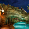 """<h2>Swimming Through the Grotto</h2> <br/>The swimming pool at the Aulani (a Disney hotel) on Oahu is pretty incredible. I only saw the place at night, so I'm not sure how it looks during the day. But it looks like it was designed just so that it would look awesome at night!<br/><br/>It's attached to one of those lazy rivers that bends around this way and that. I do like lazy rivers, but I don't like all the Disney lifeguards watching me on every bend. What if I want a little lazy-river privacy? Well, I guess there's no need for that with kids about and such.<br/><br/>- Trey Ratcliff<br/><br/><a href=""""http://www.stuckincustoms.com/2012/07/25/swimming-through-the-grotto/"""" rel=""""nofollow"""">Click here to read the rest of this post at the Stuck in Customs blog.</a>"""