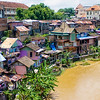 """<h2>The Homes by the river in Indonesia</h2> <br/>The density of the homes was remarkable, everyone right on top of the next. We walked down through the little houses and got a hundred good shots… each one was brightly and individually painted and festooned. <br/><br/>- Trey Ratcliff<br/><br/><a href=""""http://www.stuckincustoms.com/2008/08/17/the-homes-by-the-river-in-indonesia/"""" rel=""""nofollow"""">Click here to read the rest of this post at the Stuck in Customs blog.</a>"""