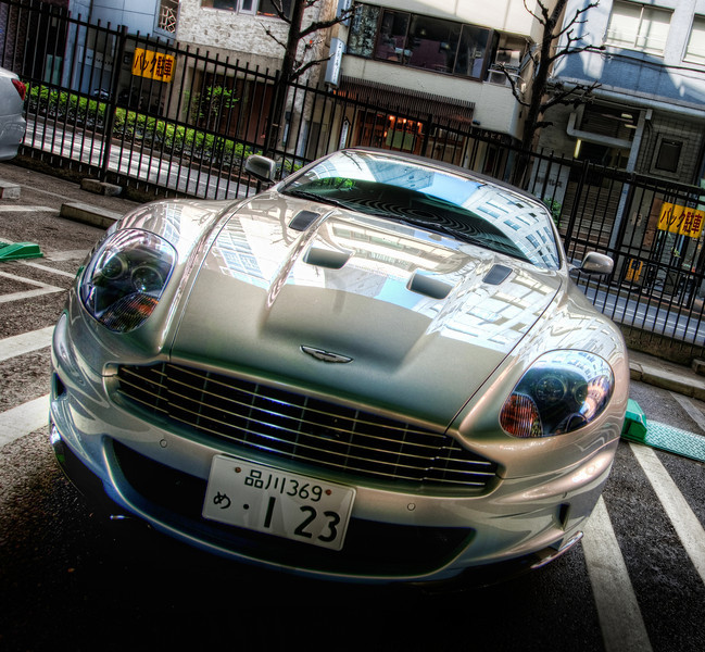 """<h2>Awesome Car in Tokyo</h2> Tokyo has a bunch of cool cars all over the place.  And look at that license plate!  How do you get that number?  Maybe you have to part of the Japanese mafia or something...<br/><br/>I took this photo a long time ago but only recently processed it.  In fact, I took it while we were doing the Tokyo workshop.  Remember that thing?  I only dedicate about 10-15% of my year to """"teaching"""" stuff, since I am so busy with other things.  This year I'm working on a bunch of different things to help this scale, however, since it is hard to be everywhere physically at the same time.<br/><br/>- Trey Ratcliff<br/><br/><a href=""""http://www.stuckincustoms.com/2012/04/23/awesome-car-in-tokyo/"""" rel=""""nofollow"""">Read the rest of this entry at the Stuck in Customs blog.</a>"""
