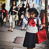 """<h2>Young Schoolgirl Returning Home in Tokyo</h2> <br/>One thing I recommend to travelers as they go from point A to point B in an unpredictable manner.  Whenever I want to hit an exact location, I tell the taxi to drop me off a few kilometers from the destination.  Either that, or I exit the subway early.  I then meander my way from street to street and feel my way to the final location.  Usually, by taking these unpredictable paths, I end up seeing a lot of things that would have been left unseen.<br/><br/>That is how I found this little schoolgirl in Tokyo.  I ended up on a busy street in the late afternoon, just as kids were running back to their homes.<br/><br/>- Trey Ratcliff<br/><br/><a href=""""http://www.stuckincustoms.com/2011/01/14/young-schoolgirl-returning-home-in-tokyo/"""" rel=""""nofollow"""">Click here to read the rest of this post at the Stuck in Customs blog.</a>"""