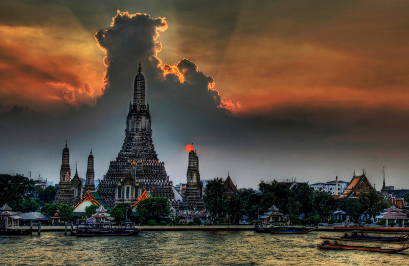 """<h2>One Night in Bangkok</h2> <br/>I arrived into Thailand this weekend and have been in content-creation mode non stop.  I did take a chance back at the hotel to process this one picture I thought y'all would enjoy.<br/><br/>(and yes that sun picture is real... it was burning through the bottom while still streaming light over the top).<br/><br/>This picture is of Wat Arun, a famous Buddhist temple in Thailand.  I took it from a really cool little Italian restaurant across the way that is attached to a boutique hotel named """"Arun Residence"""".  I will stay at this place next time - be sure to get the balcony room at the top if you come... it's just over $100 a night and is the best (and only) view of this temple in Bangkok.<br/><br/>- Trey Ratcliff<br/><br/><a href=""""http://www.stuckincustoms.com/2006/11/19/one-night-in-bangkok/"""" rel=""""nofollow"""">Click here to read the rest of this post at the Stuck in Customs blog.</a>"""