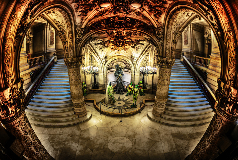 "<h2>Frogs in the Paris Opera</h2> <br/>Can someone explain this to me? I cannot figure it out. Maybe they are just being quirky.<br/><br/>I took this with a fisheye lens inside the Paris opera. I can't imagine what the internal bureaucracy is like within the Paris Opera for various art displays inside. And I can't figure out how this one got through. But maybe there is a major art meme that I missed that includes well-dressed amphibians.<br/><br/>- Trey Ratcliff<br/><br/><a href=""http://www.stuckincustoms.com/2013/04/03/frogs-in-the-paris-opera/"" rel=""nofollow"">Click here to read the rest of this post at the Stuck in Customs blog.</a>"