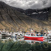 "<h2>Red Boat in Fjord Before Storm</h2> <br/>Usually once it gets dark outside, I give it another half hour or so before I go restaurant-hunting.  I like experimenting with new food while processing a few photos...  It's one of the greatest things... I usually have a table all by myself, and I get quite a large one so I can lay out all my stuff.  I order all sorts of quirky foods, and I have a diet that would make Walter from Fringe happy.<br/><br/>But this night, there was so much strange ambient light that I decided to shoot for a few more hours.  I worked my way up and down the waterside to find interesting sights.  In these situations, I usually try to have at least one of my exposures be 30 seconds.  That means the other four exposures are 15s, 8s, 4s, and 2s.  That makes a good 59 seconds per session.  I usually have my earphones on and I keep one finger on the tripod so I can feel the shutter click.  I can tell immediately if my settings are off by the vibrations.<br/><br/>- Trey Ratcliff<br/><br/>Read more <a href=""http://www.stuckincustoms.com/2011/05/31/the-deep-indigo-night/"" rel=""nofollow"">here</a> at the Stuck in Customs blog."