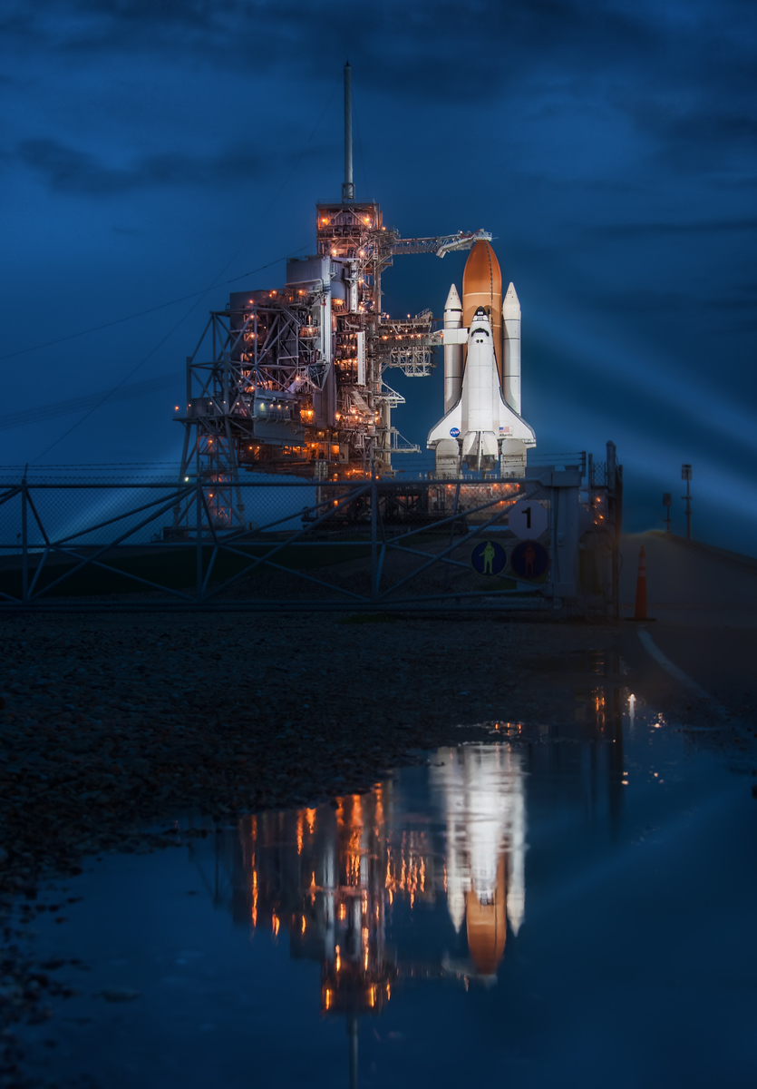 "Final Night of the Space Shuttle I was completely soaked after laying in mosquito-invested waters for an uncomfortably long time. At one point, a concerned French news reporter came up to me and said, ""Excuse me, but you're quite covered in bugs."" It must have been pretty bad for him to come over and say that... I think perhaps he thought I was dead because I stayed in the same position for so long, trying to zen-focus on the shot.  This is the Space Shuttle Atlantis, in case you do not know. It's also the final space shuttle launch, ever. So, it's incredibly special, and I'm happy I got to spend time with the ship on its final night.- Trey RatcliffRead more here at the Stuck in Customs blog."