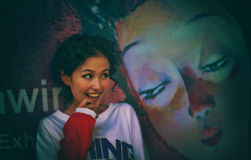 "<h2>Random Sighting in Beijing</h2> <br/>I was walking around the arts district in Beijing and saw this cute girl posing up against a wall for her friend. After I was sneaky and took this photo, she looked over and gave me an even bigger smile! hehe… I notice sometimes that girls over there take a lot of photos of each other and act silly. And then, whenever I swoop in and take a picture, they get even sillier. It's a very strange phenomenon but it's always fun.<br/><br/>- Trey Ratcliff<br/><br/><a href=""http://www.stuckincustoms.com/2013/02/03/random-sighting-in-beijing/"" rel=""nofollow"">Click here to read the rest of this post at the Stuck in Customs blog.</a>"