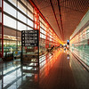 "<h2>Airports in China</h2> <br/>Asian airports are some of the best in the world, eh? <br/><br/>These architects must love designing them... they get to go crazy and try all kinds of experimental things.  Not only are they huge, but the inventive lines and shapes make them virtually inexhaustible subjects for photography!<br/><br/>This shot was taken further inside the Beijing (PEK) airport as you are approaching the gate. I kept my tripod as carry-on here for a few reasons. First, so I could take photos in the airport. Second, so I would have it at landing just in case my bag was lost! That happened in Argentina once and I haven't repeated that mistake since…<br/><br/>- Trey Ratcliff<br/><br/><a href=""http://www.stuckincustoms.com/2011/10/07/airports-in-china/"" rel=""nofollow"">Click here to read the rest of this post at the Stuck in Customs blog.</a>"
