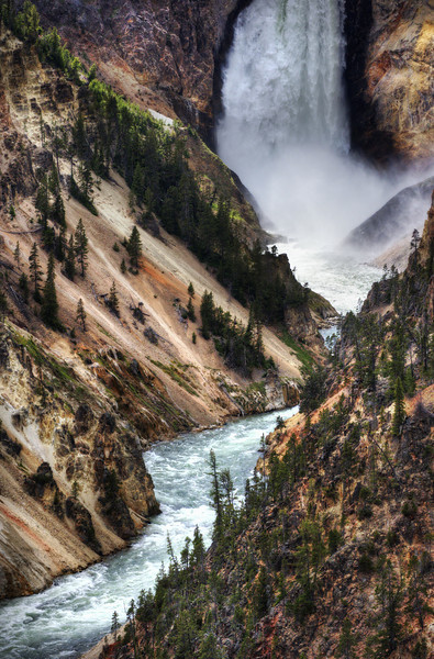 "<h2>The Falls of Yellowstone</h2> <br/>This is a very famous waterfall in Yellowstone National Park.  I was there smack dab in the middle of the day, which is just about the worst time to take photos.  So be it, Jedi.<br/><br/>I got out the old trusty and handy 200-400mm lens to take a shot.  It's not that big.  It'll fit right in your back pocket.  (BTW, see my <a href=""http://www.stuckincustoms.com/nikon-200-400-review/"">Nikon 200-400</a> Review for more).<br/><br/>- Trey Ratcliff<br/><br/>Read more <a href=""http://www.stuckincustoms.com/2010/08/17/yellowstone-falls/"">here</a> at the Stuck in Customs blog."