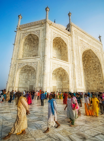 "<h2>A Godly Dance at the Taj</h2> <br/>I was barefoot like the rest of them.<br/><br/>The day must have been around 95 degrees and as stuffy as can be, but the cool marble seemed to keep me from being drenched in sweat.  After a long walk, I had finally made it to the inner core of the Taj Mahal, around the main tomb structure where pilgrims from all over the country had gravitated.  The faithful coiled in long lines and snaked their way around the complex, waiting patiently to reflect at the megamausoleum and communing with the god of their choice.  How could a billion people be wrong?<br/>When I travel, I actually always enjoy talking to Indians (or whoever) about their religion.  Here is a little thing I do... I'm not sure it's totally ethical since I say the same thing over and over, but I enjoy seeing people's reaction as a probe a panoply of personalities.  Inevitably, when I'm in a taxi or man-powered trike-mobile, there is some sort of deity that is jiggling about on the dashboard or handlebars.  It can be anyone from Shiva to Brahma to Vishnu to Krishna to Ganesha and beyond.<br/><br/>So, I always ask, ""Who is the god to whom you pay reverence?""<br/><br/>They respond quickly and directly, usually naming one from of the top ten from the pantheon of possibilities.<br/><br/>I respond back, in all seriousness, ""Oh!  He is a <em>very</em> powerful god!""<br/><br/>To this, they always turn to me and nod gravely.<br/><br/>My guide there was from no from one of the traditional Hindu sects -- he was a Jain.  The Jain don't recognize the divine origins of the Vedas (made popular in the US from Oppenheimer's re-quote after testing the Bomb), nor do they believe in any one supreme deity.  They instead revere Tirthankaras who have raised themselves to divine perfection.  So anyway, if you ever try out the little trick above, don't bother with a Jain because they will just give you a funny look and a wobble of inconsequential solitude.<br/><br/>So if any of you get the chance to go, I recommend it.  The people are all nice as can be and very eager to engage in conversation about just about everything.  Or, of you've already been, then you know what I mean!<br/><br/>By the way, this comes from my new <a href=""http://www.stuckincustoms.com/lucis-tutorial/"">Lucis Tutorial</a>.<br/><br/>- Trey Ratcliff<br/><br/><a href=""http://www.stuckincustoms.com/2009/03/05/a-godly-dance-at-the-taj/"" rel=""nofollow"">Click here to read the rest of this post at the Stuck in Customs blog.</a>"