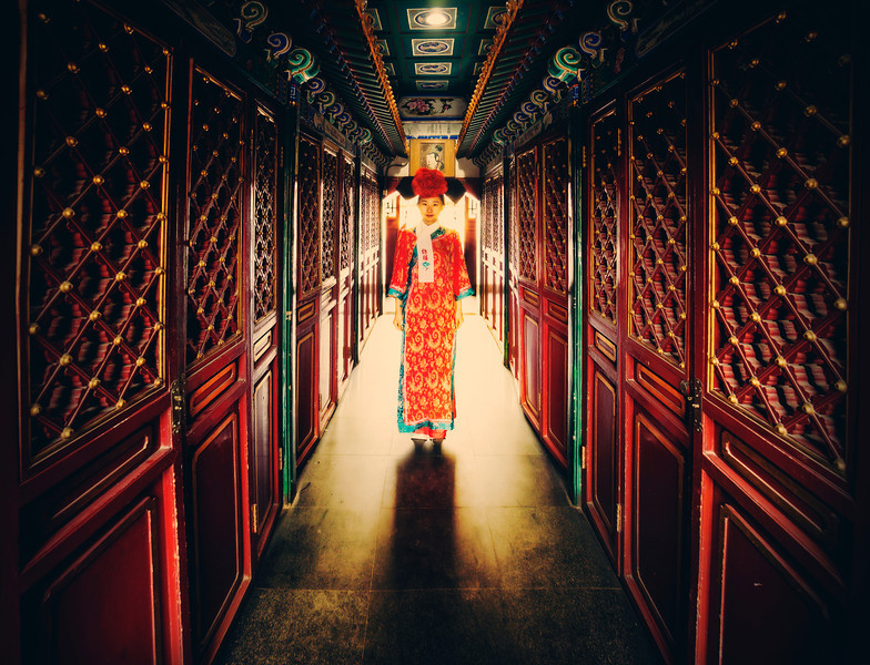 """<h2>In the Imperial Hallways</h2> <br/>I went over to Baihei Island in Beijing to visit some of the older parts and see what it looked like inside some of the temples. As you can imagine, everything was quite detailed and ornate. There was even some amazing food that was prepared for us by a chef at the restaurant there. And then, to my surprise, this richly decorated woman came out to serve it to us. As she was walking back through one of the old hallways, I asked her to stop for a second so I could take a photo.<br/><br/>And yes, this was taken with the Sony NEX-7. All of my new photos from China were taken with that camera…<br/><br/>- Trey Ratcliff<br/><br/><a href=""""http://www.stuckincustoms.com/2013/06/12/in-the-imperial-hallways/"""" rel=""""nofollow"""">Click here to read the rest of this post at the Stuck in Customs blog.</a>"""