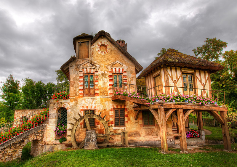 """<h2>The Little Country Stone Cottage</h2> <br/>This is where Marie Antoinette headed when she wanted to get away from it all, that is, while she was still headed. <br/><br/>This location is out in the gardens around Versailles. And it's not just a little short walk to the main part of Versailles. I bet Marie had to jump into a horse and carriage to over and visit the rest of the family in the palace!<br/><br/>- Trey Ratcliff<br/><br/><a href=""""http://www.stuckincustoms.com/2013/06/09/the-little-country-stone-cottage/"""" rel=""""nofollow"""">Click here to read the rest of this post at the Stuck in Customs blog.</a>"""