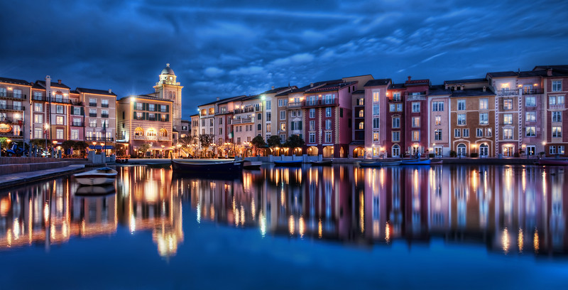 """<h2>As Night Settles on the Old Lake</h2> <br/>Here is another photo that is too good to be true… and, unfortunately, it is.<br/><br/>This is a replica of Portofinio, Italy. It's a resort hotel in Orlando, Florida at Universal Studios. It's so wonderfully fake — and so wonderful at the same time. I can't quite decide if I like the fakeness of it all. It does make for amazing photos, though, so that is cool. Maybe it's kind of like a really hot girl that has had a lot of plastic surgery. There's some fake in there, but it's still nice to look at. Okay that's a horrible analogy… but you get the idea…hehe.<br/><br/>- Trey Ratcliff<br/><br/><a href=""""http://www.stuckincustoms.com/2012/01/01/happy-new-year-2/"""" rel=""""nofollow"""">Click here to read the rest of this post at the Stuck in Customs blog.</a>"""