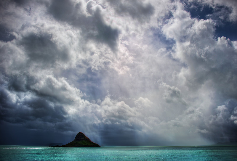 """<h2>Chinaman's Hat</h2> <br/>Also known as Mokolii, this distinctive island seems to stay in your view for a few hours as you go along the coast of Oahu.<br/><br/>EXIF-hunters will notice that I used my D3S to take this photo instead of my D3X.  I had to give that D3X a rest after getting it too wet over the previous four days of rainfall.  In fact, this was the first opening of the skies after an endless torrent of water and storm.  I was so happy to see some dynamic skies and be in the perfect spot when it happened…<br/><br/>- Trey Ratcliff<br/><br/><a href=""""http://www.stuckincustoms.com/2012/03/19/chinamans-hat/"""" rel=""""nofollow"""">Click here to read the rest of this post at the Stuck in Customs blog.</a>"""