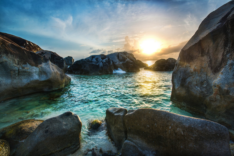 "<h2>Boulders at the Beach</h2> <br/>This is quite a unique beach, isn't it?<br/><br/>I came down to these boulders many times per day. The light was different, and on this particular evening, I was hoping for a good sunset. The kharma must have built up because everything came out quite nice…<br/><br/>And even better, the water was warm enough to wade into…<br/><br/>- Trey Ratcliff<br/><br/><a href=""http://www.stuckincustoms.com/2012/07/27/how-to-set-up-a-large-scale-live-webinar-with-youtube-live-and-google-hangouts/"" rel=""nofollow"">Click here to read the rest of this post at the Stuck in Customs blog.</a>"