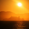 "<h2>Alcatraz at Sunset</h2><br/>I was over on Treasure Island one evening taking photos when I saw the sun sinking through a lot of moisture in the air. I also saw Alcatraz out in the water, so I jumped in the car to drive around and find a spot where everything lined up together. That was a great night!<br/><br/>- Trey Ratcliff<br/><br/><a href=""http://www.stuckincustoms.com/2012/07/04/alcatraz-at-sunset/"" rel=""nofollow"">Click here to read the entire post at the Stuck in Customs blog.</a>"