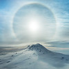 A Polar Sunbow Erupts over an Iced Volcano