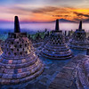 """<h2>The Caged Buddhas Look Outward Towards the Sunrise</h2> <br/>If you want to see how I made this (and how you can too!), visit my <a href=""""http://www.stuckincustoms.com/hdr-tutorial/"""">HDR Tutorial</a>.  I hope it gives you some new tricks!<br/><br/>Each of these """"bells"""" is really a stone cage that houses a Buddha statue that is seated, facing outwards.  At this time in the morning, you can take little flashlights and peer inside the cages.  It's all very eerie and fun...<br/><br/>In the distance, you can see a few volcanoes poking through the mist.<br/><br/>- Trey Ratcliff<br/><br/><a href=""""http://www.stuckincustoms.com/2008/10/06/the-caged-buddhas-look-outward-towards-the-sunrise/"""" rel=""""nofollow"""">Click here to read the rest of this post at the Stuck in Customs blog.</a>"""