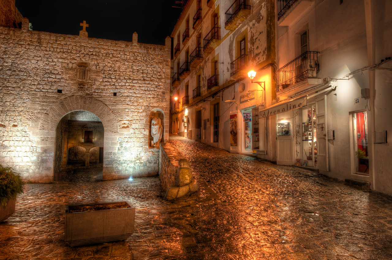 Exploring Ibiza at Night The old medieval town of Ibiza is an awesome place for exploration at night.  Every nook, cranny, alley, and cobblestone street was built for photography.  And it was doubly-awesome after a little rain gave everything a reflective sheen.After we finished dinner, we started the long walk back to the hotel.  It took 10x as long as normal with all the stops along the way.  But comon... how can you walk past something like this and not take a photo?   Impossible!- Trey RatcliffClick here to read the rest of this post at the Stuck in Customs blog.