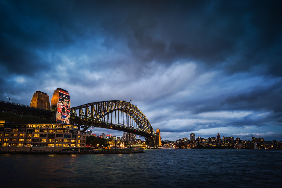 The Amazing Bridge in Sydney I think I took this during the Sydney photowalk – I am not sure! But those clouds seem very familiar. I took So Many Photos in Sydney… thousands… and I've processed hundreds so far. But I just can't remember exactly when I took this one! Maybe someone from Sydney can confirm that I took this that evening.I really wanted to get up there on the bridge, but they don't let you take your camera, which is a real bummer. I wish I could get special permission some time. Whoever can get me special permission can go with me – that would be a blast! :)- Trey RatcliffClick here to read the rest of this post at the Stuck in Customs blog.