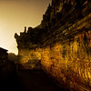 "<h2>The Dark Temple Corridor in Morning Mist at 4 AM</h2> <br/>I arrived at the temple of Borobudur a little after 4 AM. I had a tiny disposable flashlight, and, other than my driver idling about a mile away, I was the only person here. In fact, it was my second day in a row to do this, since I had so much fun the first. I was there with my friend Will, and he decided to sleep in the second day… but I had a few shots in mind I wanted to grab before the sun came up. <br/><br/>There were these strange argon lights around the temple to light up areas of excavation. They cast a gloomy and surreal light on the Buddhist reliefs that make concentric circles up to the top. I was able to get about 45 minutes of nice darkness with unexpected light until the sun started to appear over the nearby volcanoes and jungle mist. <br/><br/>- Trey Ratcliff<br/><br/><a href=""http://www.stuckincustoms.com/2009/01/04/2173/"" rel=""nofollow"">Click here to read the rest of this post at the Stuck in Customs blog.</a>"