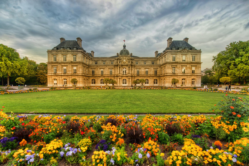 """<h2>Gardens in Paris</h2> It was a cool and rainy morning when we left our hotel in the Latin district of Paris.  The rains stopped just as soon as we walked into the nearby gardens.  The sun would peek out from between the clouds and splash some extra light on the flowers below.<br/><br/>I took a bunch of photos before the sun came out, thinking it was the best I could do.  But then after the sun came out, I had to run around and re-create the exact same photos with the proper lighting!  So, it took us twice as long to get through the gardens... but that is not such a bad thing.<br/><br/>- Trey Ratcliff<br/><br/><a href=""""http://www.stuckincustoms.com/2012/04/26/gardens-in-paris/"""" rel=""""nofollow"""">Click here to read the entire post at the Stuck in Customs blog.</a>"""