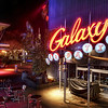 "<h2>The Galaxy Cafe</h2> <br/>When I was recently at Universal Orlando, Ethan and I made a late night getaway to do some exploration.  We were staying at the Portofino, and they have a wonderful boat system that skirts you down to the main park.  We jumped on the boat after dark to go down and visit this little area of shops, restaurants, and dozens of other interesting things to see and experience.  I've gotten him used to the idea of roaming aimlessly, taking photos of this and that, with no real goal other than exploration and noticing little things.<br/><br/>Ethan and I stopped at a tiny trinket store and bought a few necklaces and bracelets for ourselves and the girls.  After that, we grabbed a few hot cocoas, got on the boat, and drifted back home.  We took our time, drank our hot cocoas, and helped each other put on our bracelets.<br/><br/>- Trey Ratcliff<br/><br/><a href=""http://www.stuckincustoms.com/2010/05/11/the-galaxy-cafe/"" rel=""nofollow"">Click here to read the rest of this post at the Stuck in Customs blog.</a>"