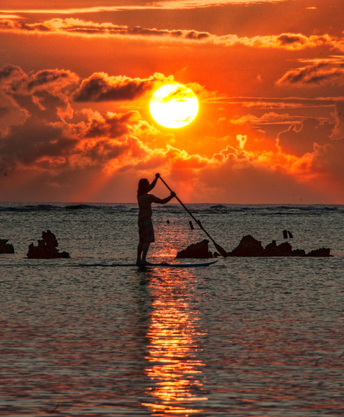 """<h2>Paddleboard in Hawaii</h2> The weather in Hawaii was rather dour and dismal for most of my trip. I only caught one sunset while there, so I decided to try to make the most of it.<br/><br/>This lone paddleboarder was skating across the surface of the ocean while I was walking along the beach. Although this photo looks fairly serene and calm, I was not. You only get one chance for this shot, unless you are willing to take a shot, sprint, take a shot, sprint, take a shot, SPRINT, etc. I'm sure people on the beach thought I was a loon, but I couldn't think of any other way to get it done!<br/><br/>- Trey Ratcliff<br/><br/><a href=""""http://www.stuckincustoms.com/2012/04/11/paddleboard-in-hawaii/"""" rel=""""nofollow"""">Read the rest of this post at the Stuck in Customs blog.</a>"""