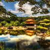 "<h2>The Golden Pavilion</h2> <br/>(or Kinkaku-ji for my new Japanese friends)<br/><br/>This is one of the most famous temples in Kyoto, so of course I had to go.  It's sort of like going to the Eiffel Tower in Paris or Rudy's BBQ in Austin.<br/><br/>It was originally built back in 1397 and has been destroyed and rebuilt several times.  The building itself is as meticulous as the gardens around it.  The Japanese really know how to tend a garden!  There was a fleet of workers all over the grounds, sweeping up and rearranging little bits here and there.  It was all very quaint and wonderful.<br/><br/>- Trey Ratcliff<br/><br/><a href=""http://www.stuckincustoms.com/2009/10/09/the-golden-pavilion-or-kinkaku-ji-for-my-new-japanese-friends/"" rel=""nofollow"">Click here to read the rest of this post at the Stuck in Customs blog.</a>"