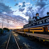 "<h2>The Train Station in Dunedin</h2> <br/>I've only spent one night in Dunedin, which is on quite far south on the South Island of New Zealand. This train station is very famous and quite beautiful. There was a crazy sunset this night, and there was no train traffic at all, so I felt pretty safe running all around the tracks and jumping up on the train cars to get direction. Actually, jumping around train cars is not very easy. It looks like it might be easy, but everything is just beyond an easy jump or an easy boost! <br/><br/>- Trey Ratcliff<br/><br/><a href=""http://www.stuckincustoms.com/2013/07/21/the-train-station-in-dunedin/"" rel=""nofollow"">Click here to read the rest of this post at the Stuck in Customs blog.</a>"