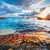 """<h2>Painting the Sunset</h2> <br/><p>It's strange to have multicolored coral so close to the beach, but it gave this whole sunset and turquoise water an even more dynamic palette. I've been getting used to using a wide-angle lens and aiming it down at the surf. It really distorts everything, but it's hard to see the distortion in the final shot. Also, I like the effect — it tends to make everything point a little bit towards the center.</p><br/><br/>- Trey Ratcliff<br/><br/><a href=""""http://www.stuckincustoms.com/2012/12/19/painting-the-sunset/"""" rel=""""nofollow"""">Click here to read the rest of this post at the Stuck in Customs blog.</a>"""