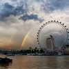 "<h2>Rainbow over the London Eye</h2> <br/>Today's shot is of the newly famous London Eye.  It's more than just a ferris wheel.  I can understand why it was so controversial when it was being built.  What proper city would want a carnival-esque attraction right in the middle of it all?  Well, this is no regular ferris wheel.  It's at least four times bigger than most, and each capsule is like a tiny plane.  Sadly, I didn't have a chance to go inside for a ride...  <br/><br/> - Trey Ratcliff <br/><br/>Find out why <a href=""http://www.stuckincustoms.com/2010/09/16/the-london-eye/"">here</a> at the Stuck in Customs blog."