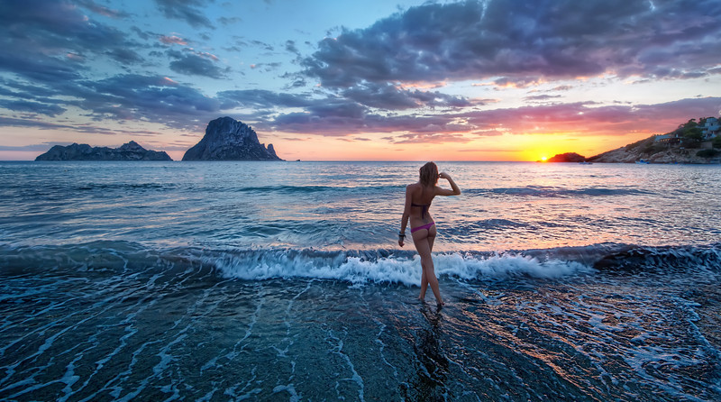 "<h2>Sunset in Ibiza</h2> <br/>Ibiza is a fabulous island off the coast of Spain that is the ""in"" destination for all the Euros that like to get trashed, party, dress in white, do medium-level-drugs, and stay on the beach without many clothes.<br/><br/>I saw this girl bouncing around and very happy about something, so I went over and said hello, introducing myself.  She didn't speak much English, but I managed to ask her if I could take a photo of her.  She enthusiastically said yes, and I explained the sitch as we walked over to the water, mostly using interpretive dance to span the language gap.  She was Italian and her name was Wendy.  I think that is a strange name for an Italian, but I didn't question it.  Anyway, I asked her just to walk off into the ocean and I would take a photo.  She did just that, and I grabbed this shot just as the sun was dipping below the horizon.<br/><br/>- Trey Ratcliff<br/><br/>The rest of this entry resides <a href=""http://www.stuckincustoms.com/2010/09/30/ibiza-girl/"">here</a> at stuckincustoms.com."